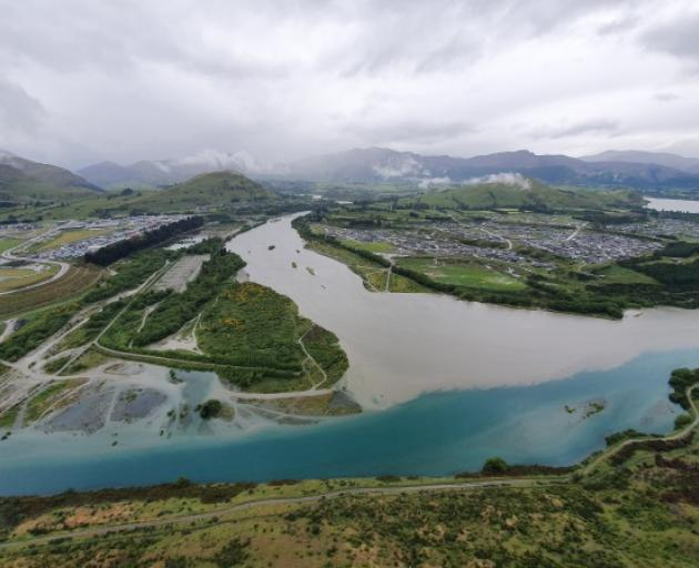 The big wet: The Kawarau River, with the end of Queenstown Airport's runway to the left, and the Shotover Country and Lake Hayes Estate subdivisions to the right. Photo: Mountain Scene