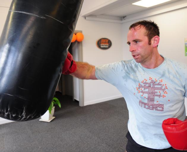 Gary Dawkins works the punching bag. Photo: Craig Baxter
