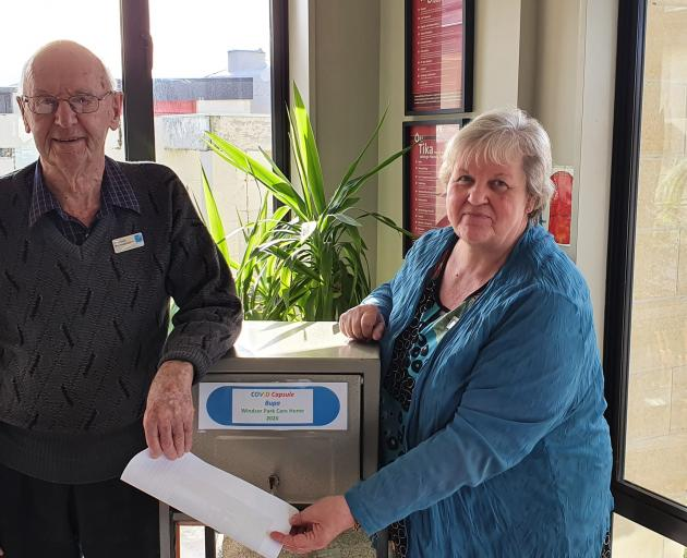 Bupa Windsor Park Care Home resident Gilbert Winwood (95) and care home manager Lynda Harding...