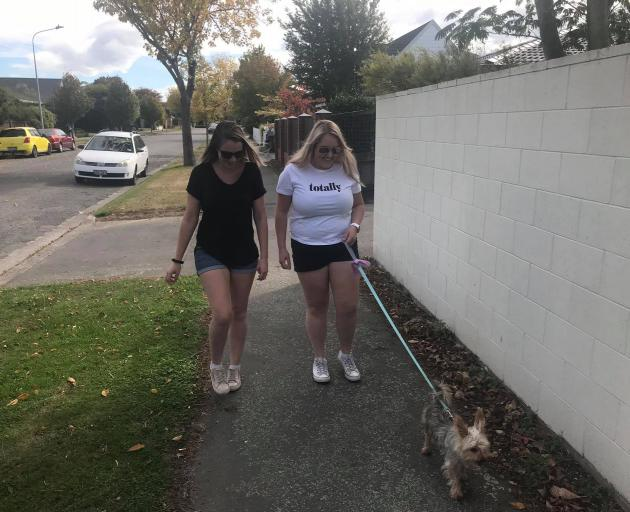 Holly and Renee take dog Bailey for a walk in Upper Riccarton.