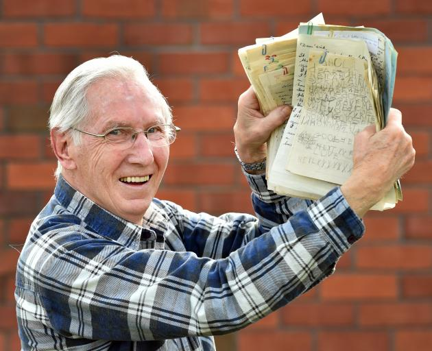 Mosgiel resident Neil Hall (82) with some of the letters his late uncle, Private Ted Brooks,...