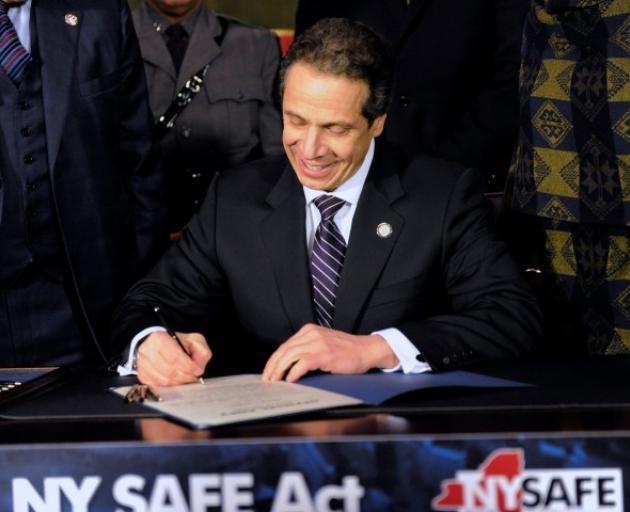 New York Governor Andrew Cuomo signs the New York Secure Ammunition and Firearms Enforcement Act...