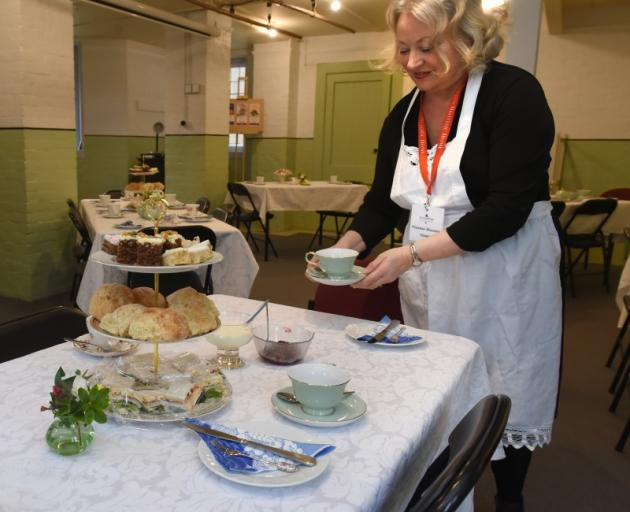 Olveston Historic Home guide Viv Houston serves an afternoon tea in the drying room. PHOTOS:...