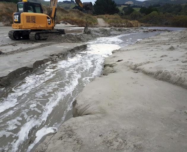 Otago Regional Council contractors widen channels at Long Beach on Wednesday and Tomahawk on...