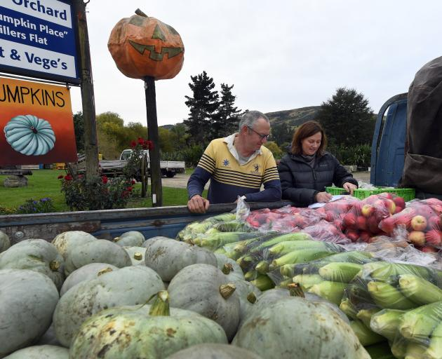 Darryl Peirce and Lynley Stuart of The Pumpkin Place, Millers Flat, check the next day's...