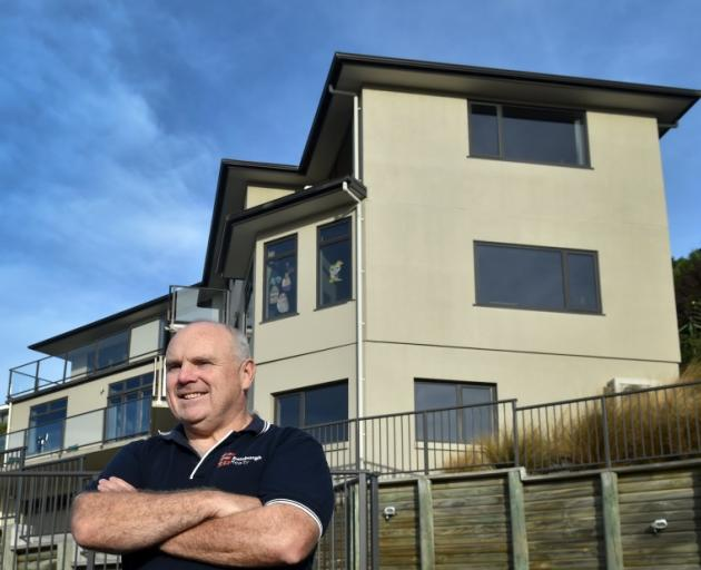 Open for business ... Peter Wilson, of Edinburgh Realty, in front of a Connell St property in...