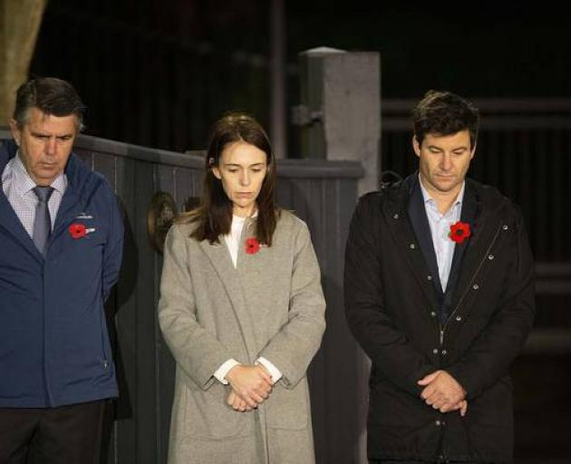 Prime Minister Jacinda Ardern stands at dawn on the driveway of Premier House with her father...
