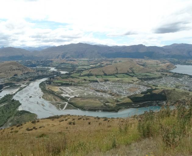 The Shotover River, with the expanding Shotover Country subdivision, at right. Photo by David Williams.