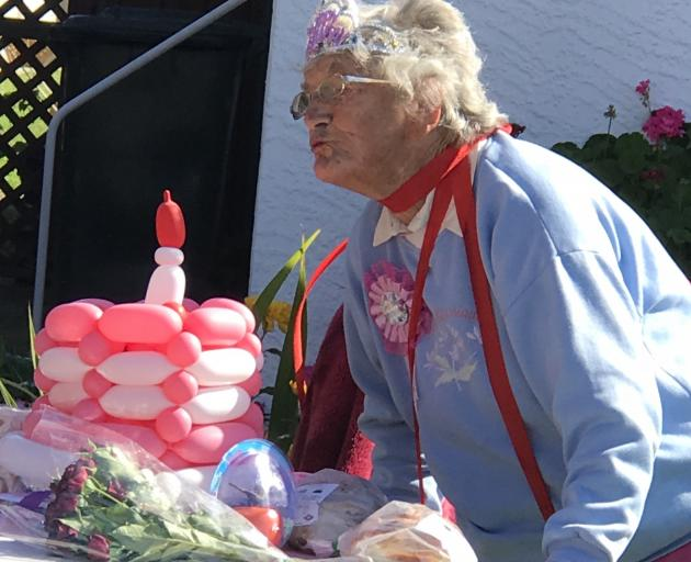 """Ursula blows out the """"candle"""" on her balloon birthday cake. Photo: Sylvia Mort"""