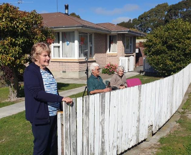 Neighbours keep their distance while wishing Ursula a happy birthday, Photo: Sylvia Mort