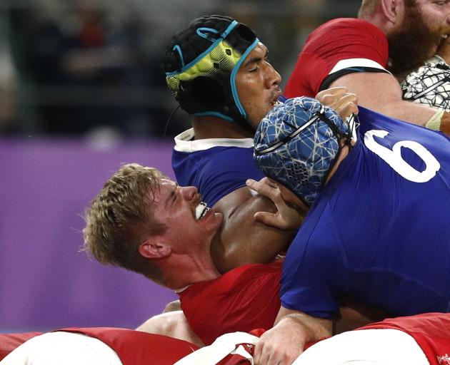 France's Sebastien Vahaamahina hits Wales' Aaron Wainwright with his elbow, turning the match....