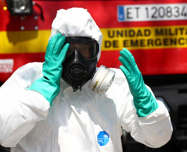 An Emergency Military Unit member prepares to disinfect in a special facility for psychically...