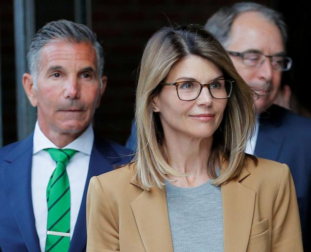 Lori Loughlin and husband Mossimo Giannulli (left). Photo: Reuters