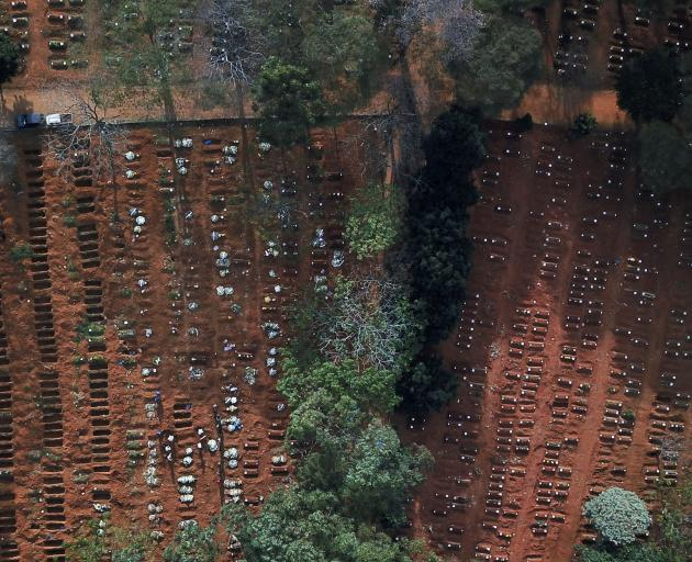 Open and occupied graves are seen during the outbreak of Covid-19, at Vila Formosa cemetery, Brazil's biggest cemetery, in Sao Paulo. Photo: Reuters