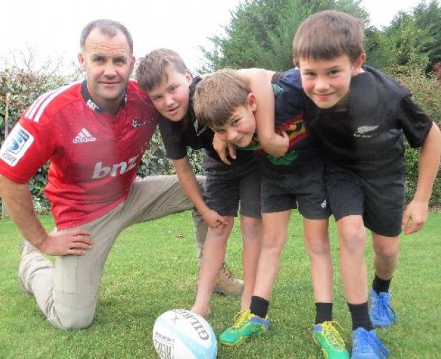 Cam Ross with rugby-mad sons (from left) Jesse, Flynn and Louie. Photo: Ashburton Courier