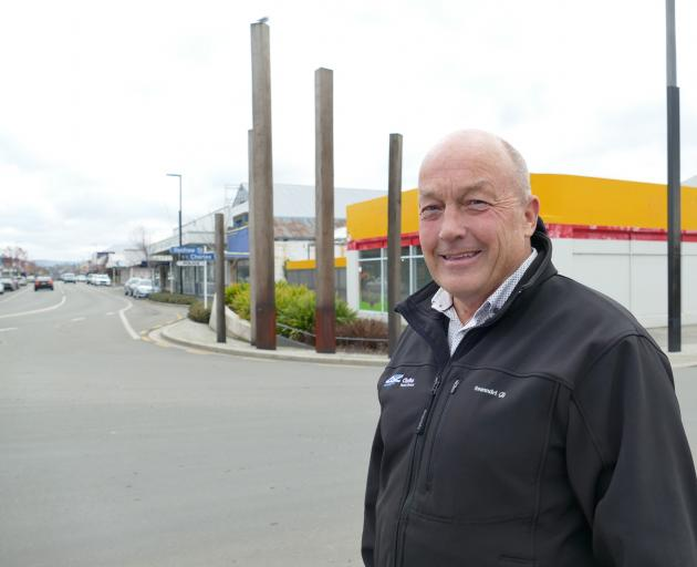 Bittersweet ... Clutha Mayor Bryan Cadogan stands in front of the proposed site of a new...