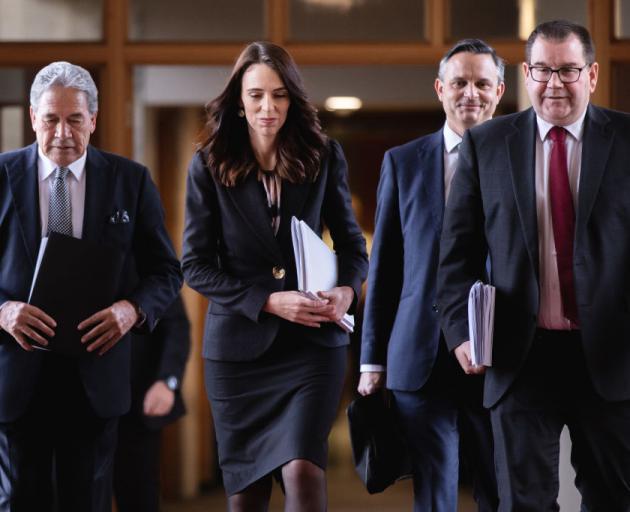 Deputy Prime Minister Winston Peters (from left), Prime Minister Jacinda Ardern, Greens leader...
