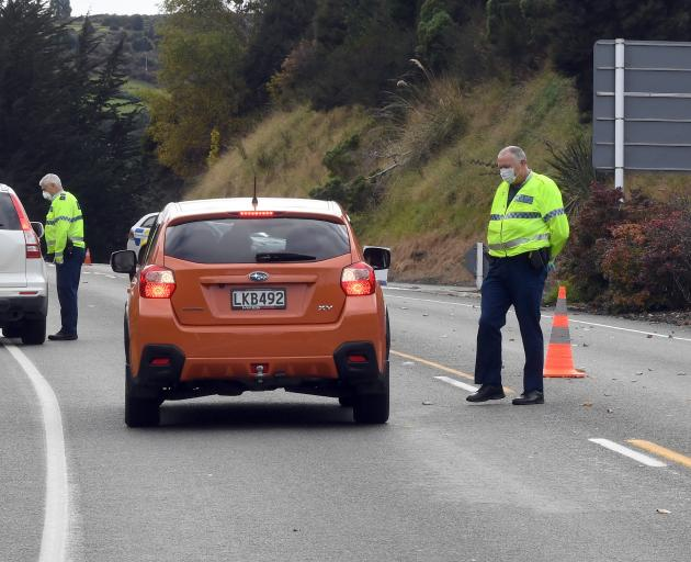 Police at a checkpoint on Dunedin's Northern Motorway on Thursday. Photo: Stephen Jaquiery