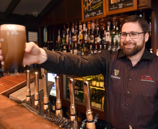 Bruce Hoffman, duty manager at Craic in the Octagon, pours a beer yesterday. PHOTO: PETER MCINTOSH