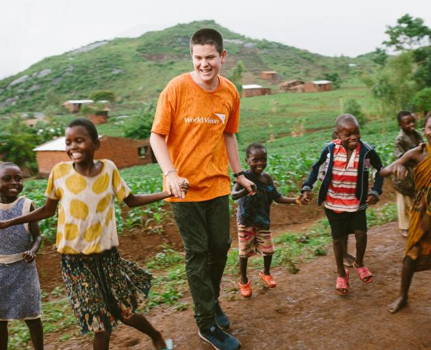 Izaac Wilson dances with Malawi children during his visit last year. PHOTO: SUPPLIED