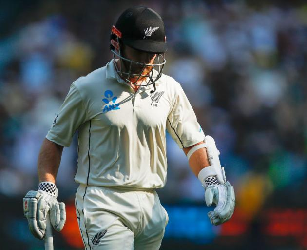 Kane Williamson of New Zealand leaves the field after being dismissed by James Pattinson of...