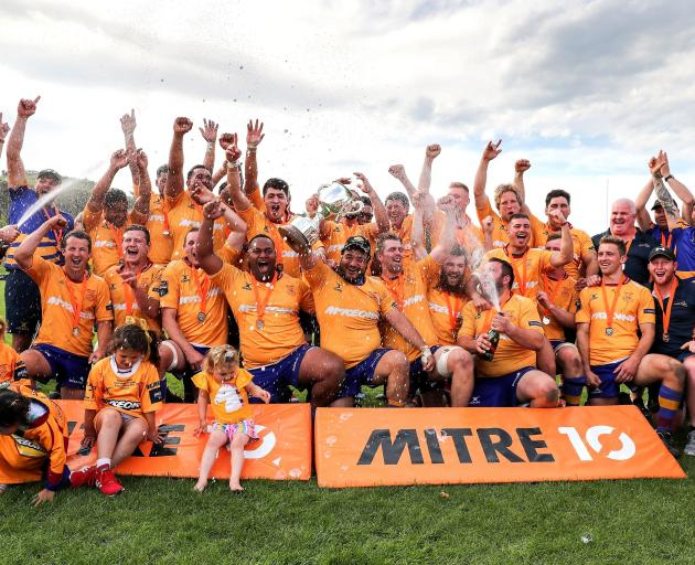 The North Otago team celebrates with the Meads Cup after beating Wanganui in the final at...