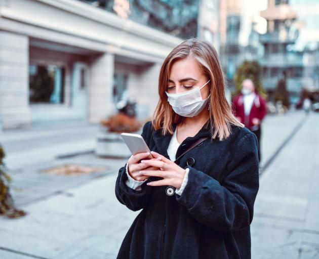 Face masks will change the way we communicate by hiding many of our nonverbal interactions. PHOTO...