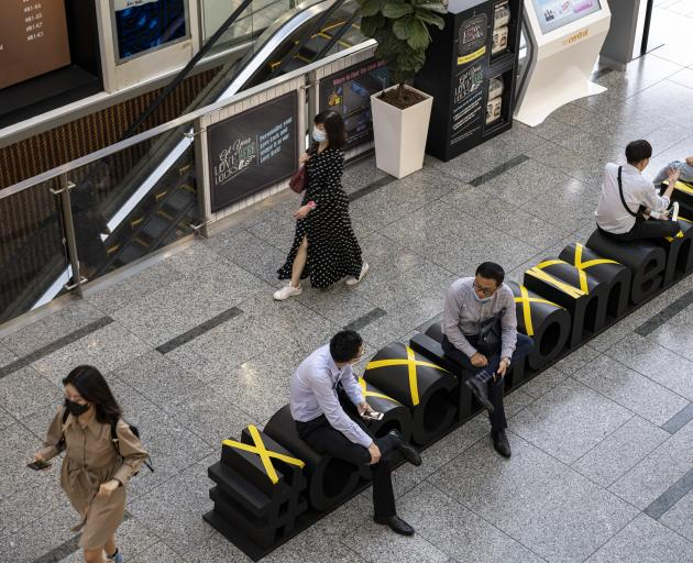 Mall users in Singapore are being asked to use an identity card-linked QR code system. PHOTO:...