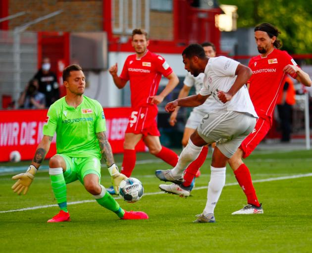 Serge Gnabry of Bayern Munich in action with Rafal Gikiewicz of Union Berlin during the...