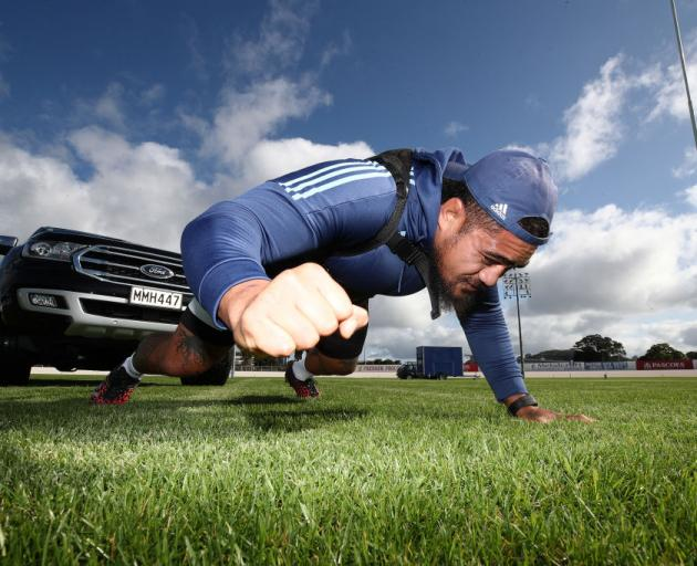 All Black and Blues prop Ofa Tu'ungafasi uses a harness to pull his SUV along, in lieu of using a...