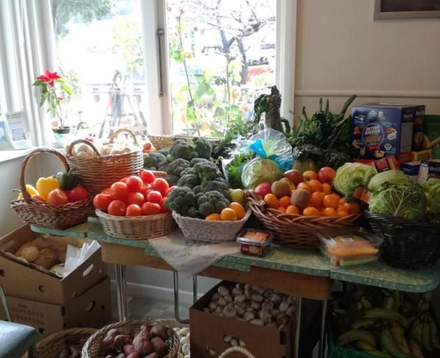 "Fruit and vegetables were given away yesterday on ""produce day"" at Happiness House Queenstown..."