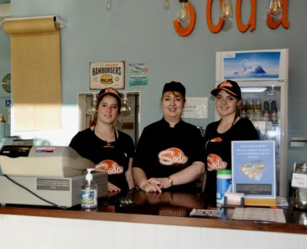 Soda Cafe and Bar owner-manager Lynda Cox, centre, with staff members, Taria Martin, left, and...
