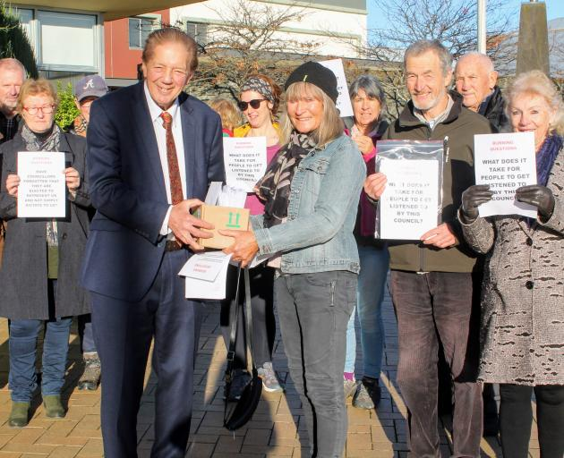 Priorities ... Mayor Sir Tim Shadbolt receives the petition from Otatara resident Penny Ivey, who...