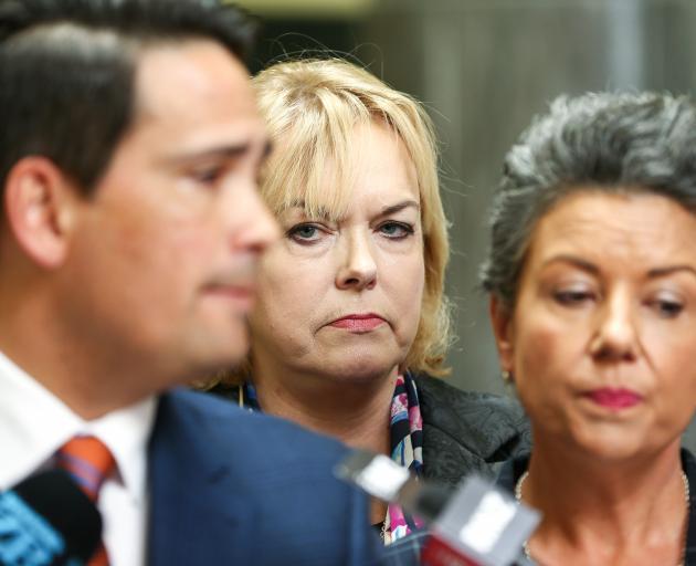 MP Judith Collins and deputy leader Paula Bennett look on while Leader Simon Bridges speaks to...
