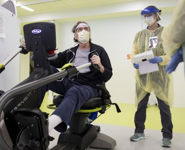 Gordon Quinn exercises with physical therapist Katie Palano on April 27, 2020, at the Shirley...
