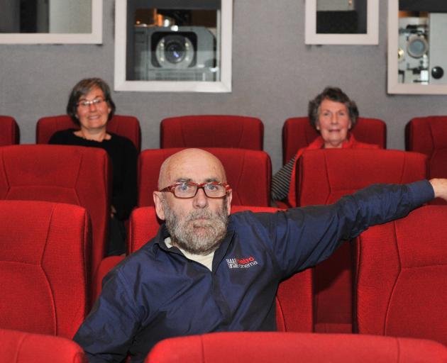 Jacki and mother Roberta Telfer take a seat near Metro Cinema owner John Wilson before the 2pm...