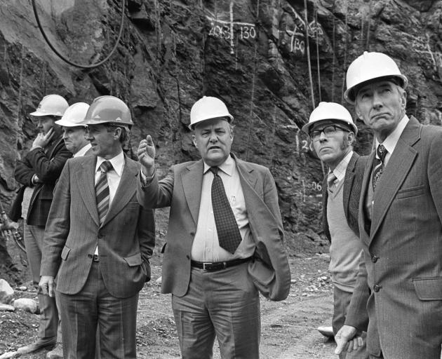 Robert Muldoon (centre) with officials at the Clyde Dam construction site during the 1980s. PHOTO...