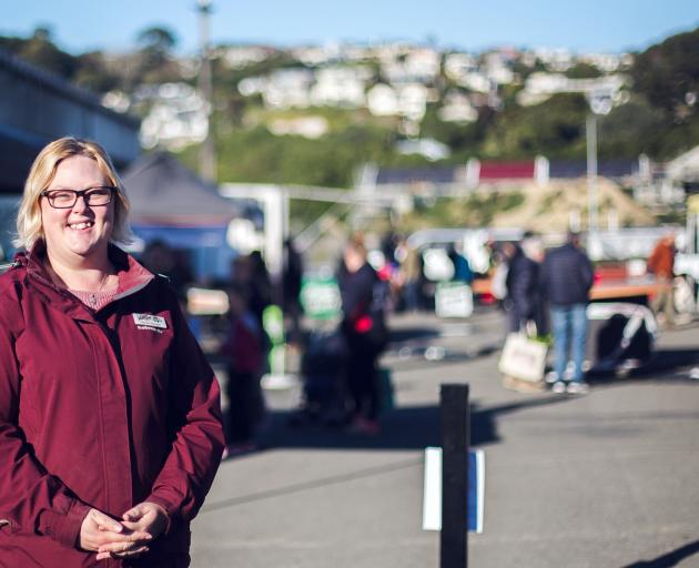 Oamaru Farmers' Market manager Maree Cadogan welcomes people back to the market yesterday, after...
