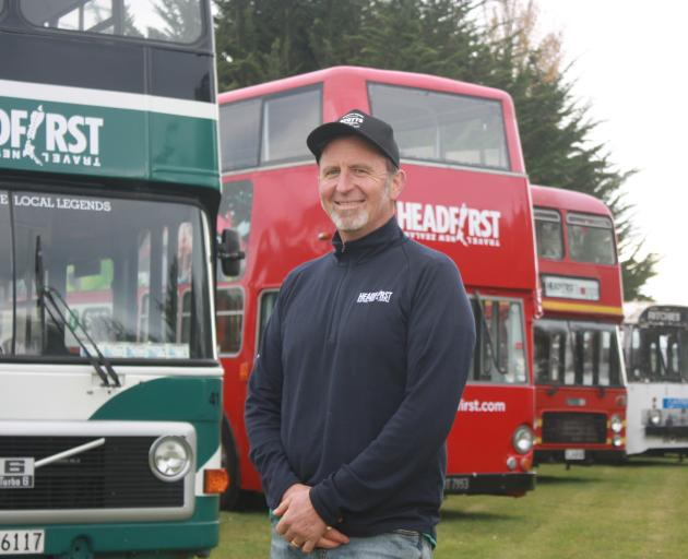 Parked up . . . Headfirst Travel co-owner Ralph Davies is surrounded by his business' buses at...