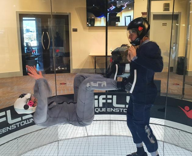Lean back ... Erica Zanei practises her skills in the wind tunnel with iFly instructor Allen...