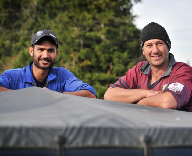 Vital part of the team . . . Dairy worker Harrie Chander (left) is a valued member of Woodside...