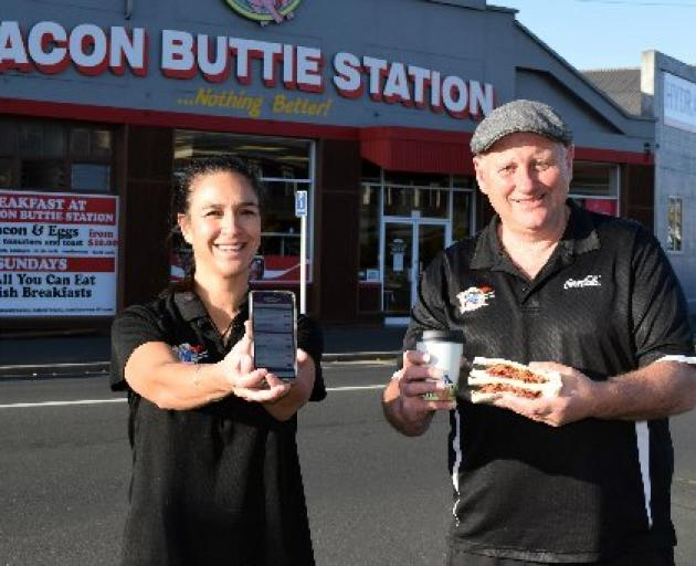 Bacon Butty Station co-owners Tia Winikerei and Mike Cornelissen reopened their eatery in central Dunedin on Tuesday. PHOTO: SHAWN MCAVINUE