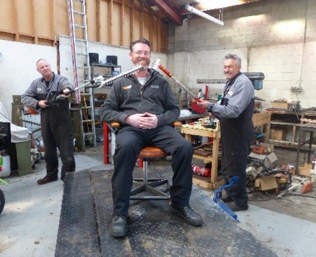 Stihl Shop Dunedin mechanics David Faigan (left) and Doug Williamson reckon they can give sales manager Shane MacGregor's new beard a trim while maintaining social distancing. PHOTO: DAVE CAMPBELL/STIHL SHOP DUNEDIN