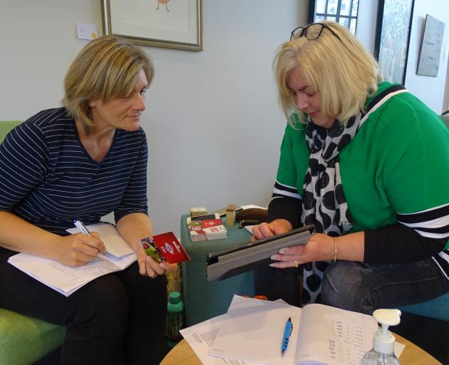 Wanaka volunteers Julia Larkin (left) and Rachelle Blatch at the Wanaka Community Hub distribute...