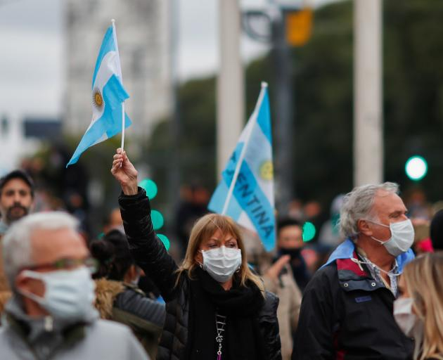 Demonstrators in Buenos Aires take part in a protest against the coronavirus quarantine measures....