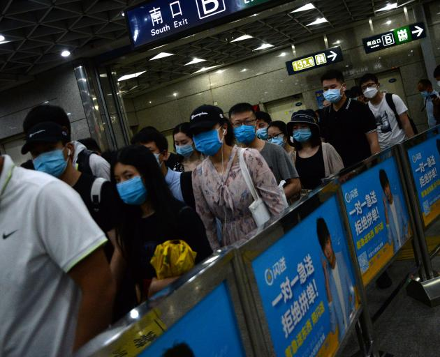 Beijing Steps Up Measures as Virus Spike Fuels Second Wave Fears