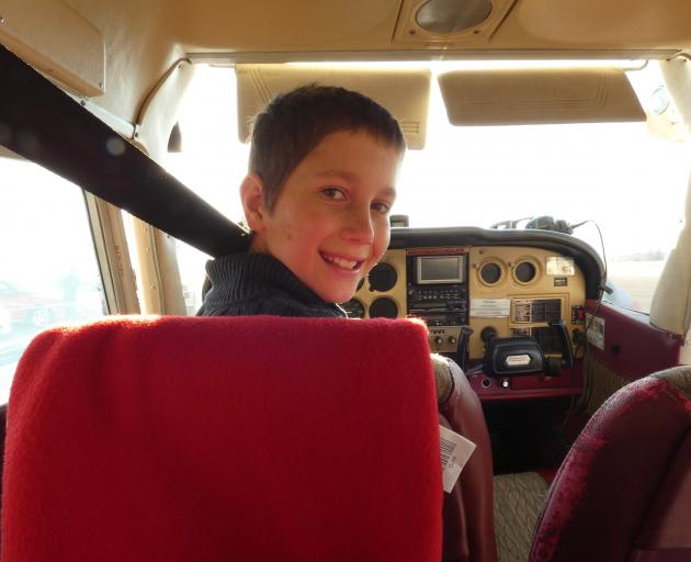Captain Jackson Nolan seems at ease before take-off. The wannabe pilot had his first taste of...