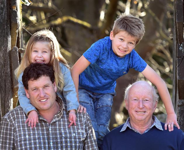 The Bathgate family of (from left) Simon, Ashlee (3), Caleb (8) and Ian, at their Taieri farm. PHOTO: PETER MCINTOSH.