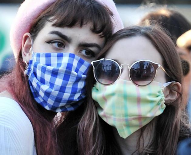Eva-Parani Collins (left), of Dunedin, and Ella, of the United States, support each other at the...
