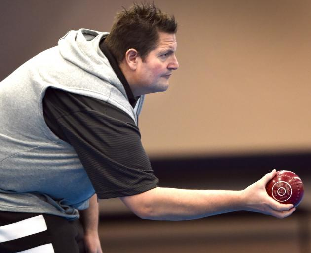 Bowler Marty Kreft is all concentration as he gets ready to deliver a bowl at the Shanghai...